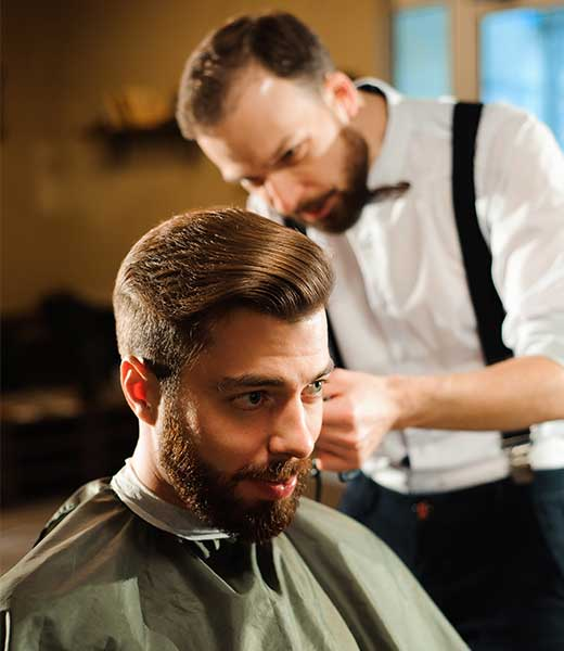 Man getting his hair styled